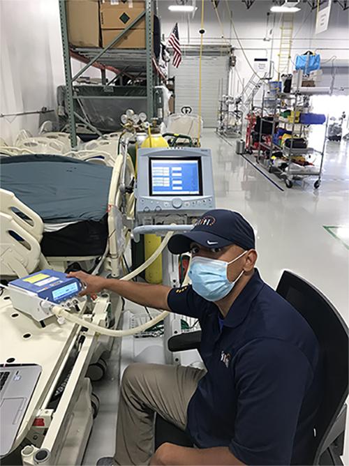 Adrian Barraza checks ventilator