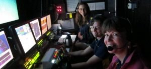 people working in dark control room